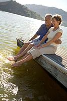 A couple sitting on a dock
