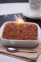 Tiramisu with burning sparkler