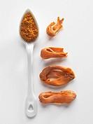 Mace and ground nutmeg on a porcelain spoon