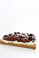 Quark, chocolate spread and cherries on bread