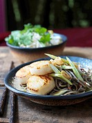 Fried scallops on pasta and lemon grass