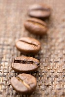 Five coffee beans close_up