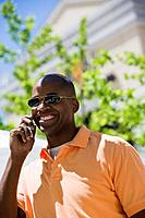 Man outdoors with cell phone