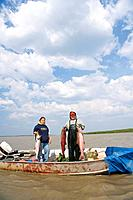 Native Yupik eskimo father & daughter subsistence drift netting for salmon Kuskokwim River WE Alaska