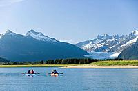 Kayakers kayaking in double sea_kayaks near Juneau in Inside Passage with view of Mendenhall Glacier Alaska