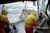Fisherman Working on Deck in 50 Knot Winds Bering Sea AK /nOpilio Crab Season F/V Erla N