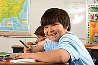 Alaskan native boy in classroom at desk inside Alaska