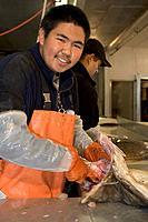 AK Native Aluet Man Processes Halibut @ Atka Pride Seafoods Atka AK SW