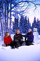 People Relax After Playing in the Snow Winter SC AK Snowman & Toboggan