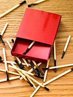Open Matchbox with burnt matches
