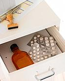Liquor and medicine in filing drawer