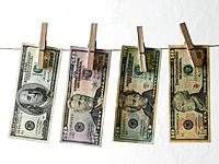 Dollar notes hanging on clothesline