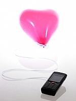 Pink heart shaped balloon with cell phone