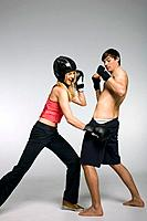 Young couple boxing, studio shot