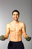 Young man holding broccoli