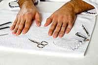 Manicure equipment around man's hands on towel