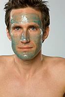 Close_up of mid adult man wearing facial mask