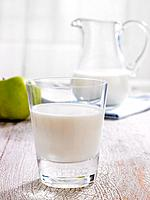 Close-up of a glass of milk with a pitcher in the background (thumbnail)