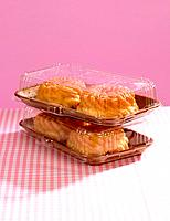 Close_up of cakes in plastic containers