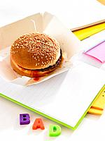 Close_up of a burger on a notebook