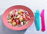 Close_up of candies with a fork and a table knife