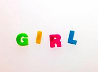 Word GIRL made from magnetic letters
