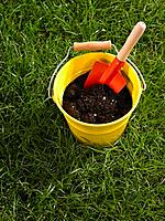 Compost and trowel in a bucket