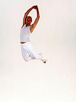 Male dancer leaping in mid_air, hands together