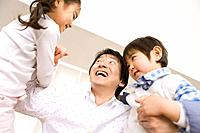 Photography of a father and children playing, Low Angle View