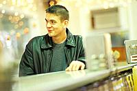 Young Man at Restaurant Counter