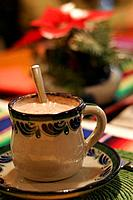 Cup of Hot Chocolate on colorful Table Setting