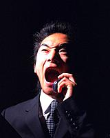 A businessmen yelling on the phone, Front View