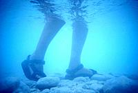 Feet Walking Underwater