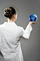 Female scientist holding a globe