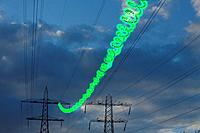 Green energy written on power lines