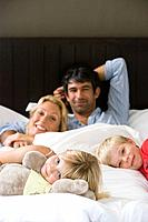 Portrait of a family in bed