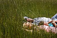 A family sleeping in a field