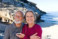 Senior couple listening to an mp3 player