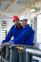Portrait of two harbour workers