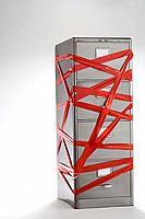 Red tape over filing cabinet