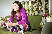 A teenage girl listening to music