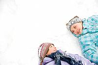 Girls lying in snow