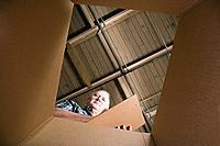 Man looking in cardboard box