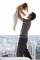 A father lifting his daughter