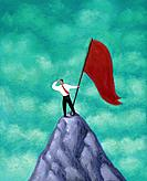 Businessman standing with red flag on mountain peak, looking out into the distance
