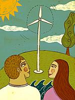 Two people looking at a wind turbine on a sunny day