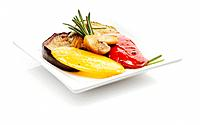 Marinated bell pepper and aubergines garnished with rosemary on plate