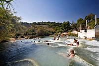 Italy, Tuscany, Saturnia, Group of people enjoying in a hot spring