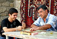 Baku _ Azerbaijan: Men playing a game in the old town of Baku.