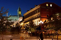City Hall, Hotel de Ville, and old building seen from along Place Jacques_Cartier at night in Old Montreal, Montreal, Quebec, Canada.